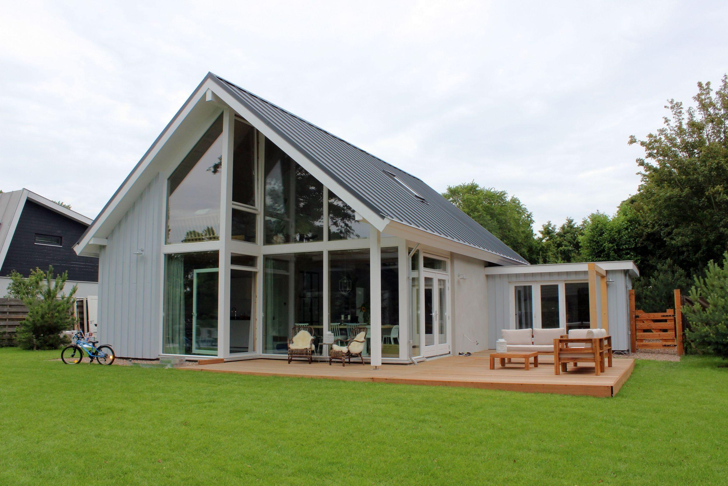 Moderne houten woning schuurwoning bouwen for Foto op hout maken eigen huis en tuin